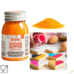 Cristalli di Zucchero Arancio glitterato, in barattolo da 100 g di Decora.