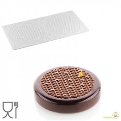 Alvéolé 9 tappeto in silicone decoro da 14 cm per torte a trama Alveare da Silikomart